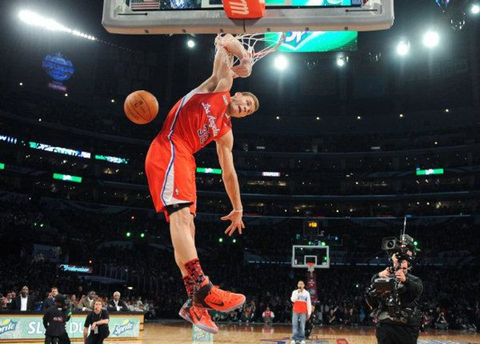Photo - L.A. CLIPPERS: Los Angeles Clippers' Blake Griffin dunks during the Slam Dunk Contest at the NBA All Star Weekend in Los Angeles, Saturday, Feb. 19, 2011. (AP Photo/Mark Ralston, Pool) ORG XMIT: CAJH103