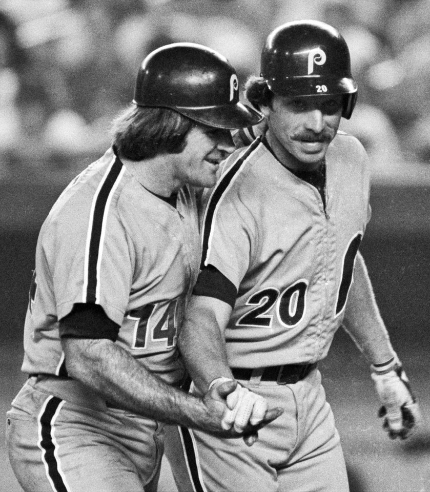 Photo - FILE - In this Aug. 15, 1981, file photo, Philadelphia Phillies' Mike Schmidt, right, is congratulated by teammate Pete Rose after hitting a two-run home run against the New York Mets in the third inning of a baseball game at New York's Shea Stadium. On the 25th anniversary of Rose's banishment from baseball, Schmidt says it is time to forgive him and put him in the Hall of Fame. (AP Photo/Ray Stubblebine, File)