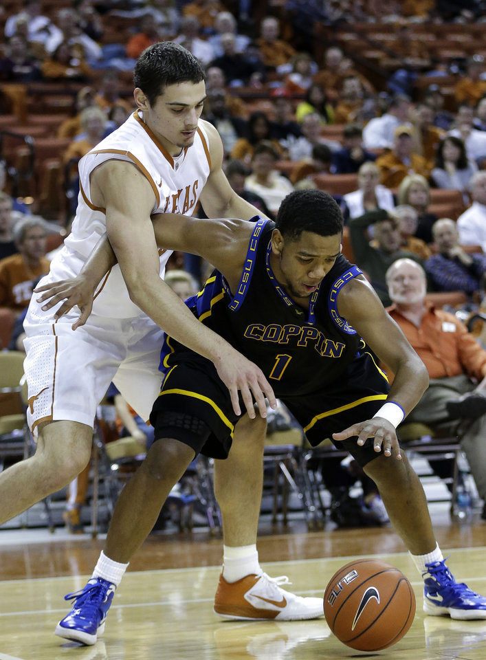 Photo -   Coppin State's Patrick Cole (1) is pressured by Texas' Ioannis Papapetrou, left, during the first half of an NCAA college basketball game, Monday, Nov. 12, 2012, in Austin, Texas. (AP Photo/Eric Gay)