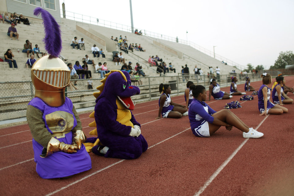 Cheerleaders and mascots kneel for an injured player at the Northwest Classen vs. Western Heights high school football game at Taft Stadium Thursday, September 20, 2012. Photo by Doug Hoke, The Oklahoman