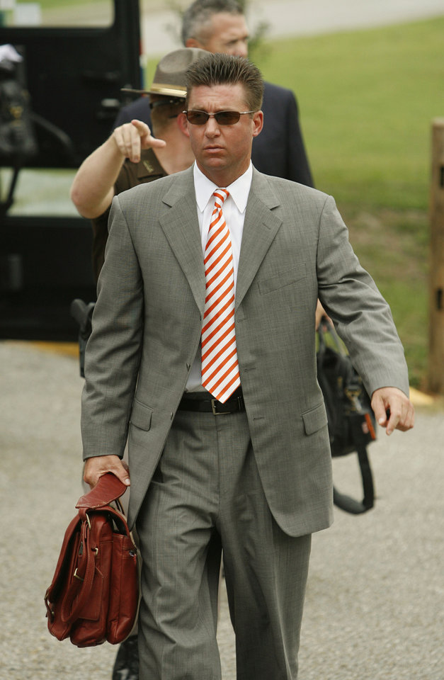 Photo - Head Coach Mike Gundy arrives with his team for their college football game between the Troy University Trojans and the Oklahoma State University Cowboys at Movie Gallery Veterans Stadium in Troy, Ala., Friday, September 14, 2007. BY STEVE SISNEY, THE OKLAHOMAN