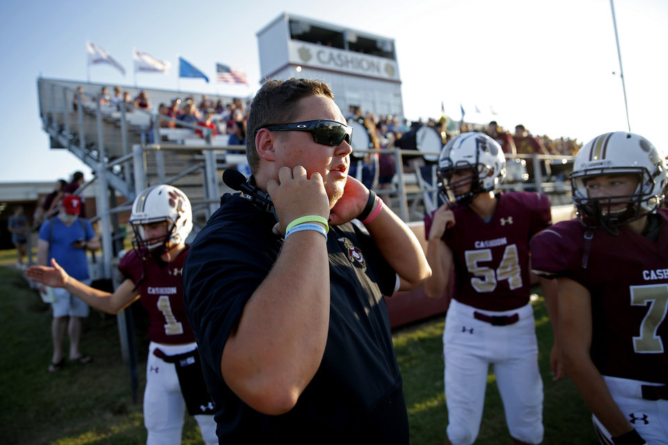 Photo - Cashion assistant coach Cale Cochran during a high school football game between Cashion and Perry in Cashion, Okla., Friday, Sept. 4, 2020. Cochran's wife, Jacie Jacie Cochran, died July 2 shortly after giving birth to their son Jaxon. [Bryan Terry/The Oklahoman]