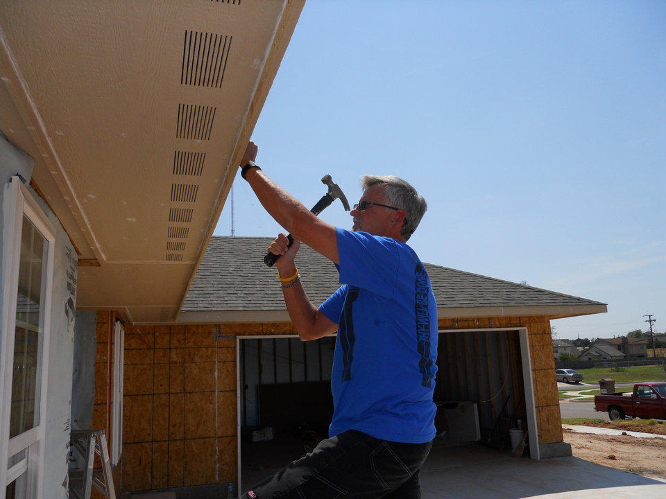 Gary Farnum works on a house for Central Oklahoma Habitat for Humanity. Farnum volunteers two days a week. - Provided