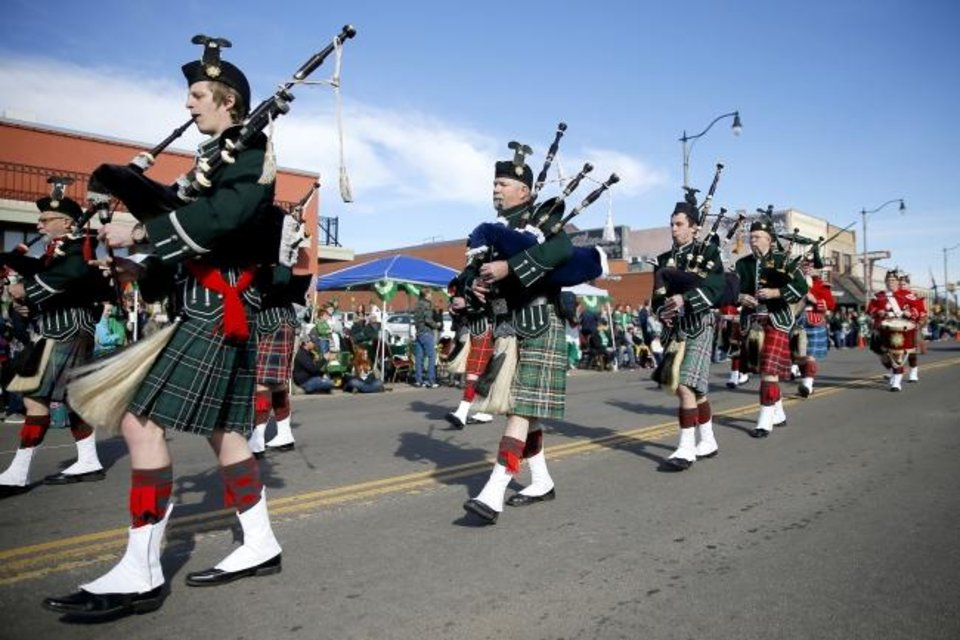 Photo -  The Pipes and Drums of the Highlanders of Oklahoma City perform during the 2019 Stockyards City St. Patrick's Parade. [BRYAN TERRY/THE OKLAHOMAN ARCHIVES]