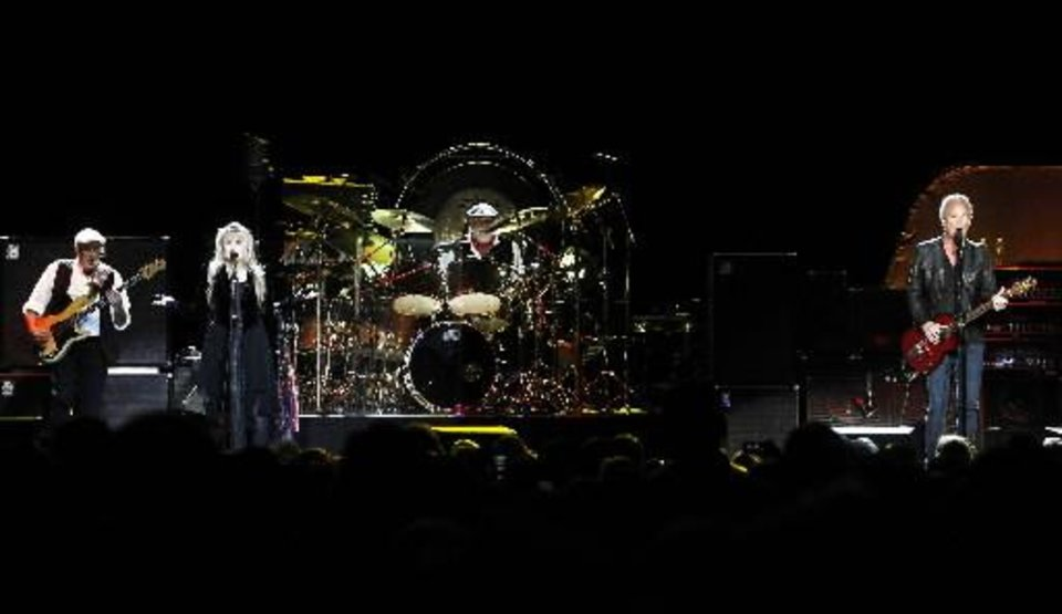 Members of Fleetwood Mac, from left, bassist John McVie, singer Stevie Nicks, drummer Mick Fleetwood and guitarist Lindsey Buckingham perform during a concert at Madison Square Garden, Monday, April 8, 2013, in New York. (Photo by Jason DeCrow/Invision/AP)