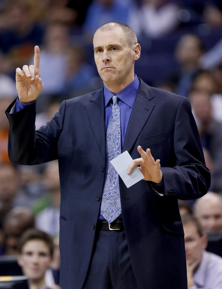 Dallas Mavericks coach Rick Carlisle calls a play during the first half of an NBA basketball game against the Phoenix Suns, Friday, Feb. 1, 2013, in Phoenix. (AP Photo/Matt York)