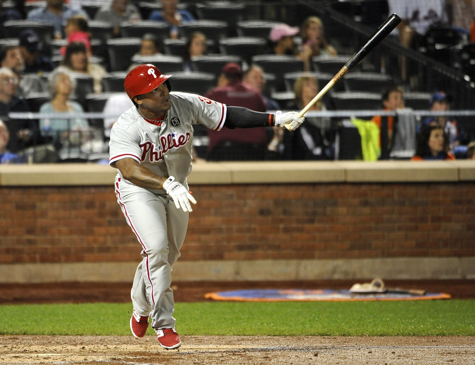 Photo - Philadelphia Phillies' Marlon Byrd watches his solo home run off of New York Mets starting pitcher Bartolo Colon in the fifth inning of a baseball game at Citi Field on Saturday, Aug. 30, 2014, in New York. (AP Photo/Kathy Kmonicek)
