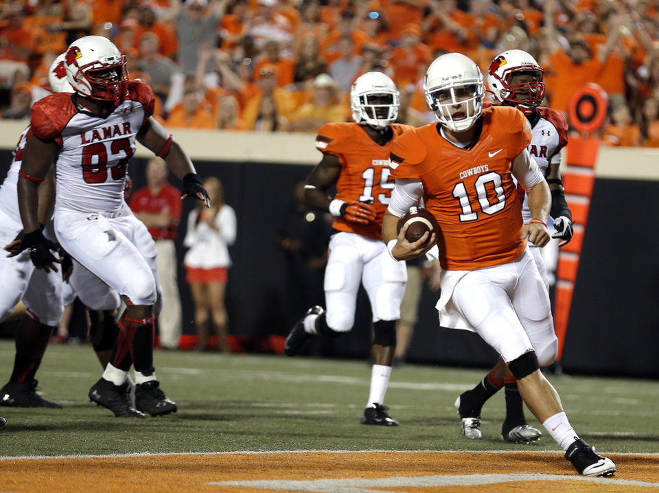 Photo - Oklahoma State's Clint Chelf (10) scores a touchdown during a college football game between the Oklahoma State University Cowboys (OSU) and the Lamar University Cardinals at Boone Pickens Stadium in Stillwater, Okla., Saturday, Sept. 14, 2013. Photo by Sarah Phipps, The Oklahoman