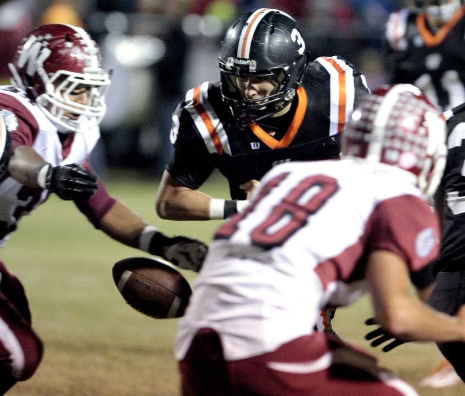 Wayne running back Louden Johnson (3) loses the ball which is recovered by Wynnewood during the first period in high school Football on Friday, Oct. 26, 2012 in Wayne, Okla.  Photo by Steve Sisney, The Oklahoman