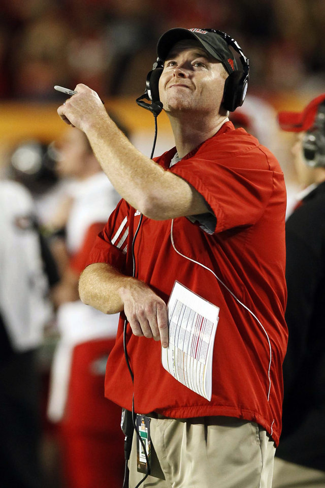 Photo - Northern Illinois head coach Rod Carey reacts at the end of the first half of Orange Bowl NCAA college football game against Florida State, Tuesday, Jan. 1, 2013, in Miami. (AP Photo/Alan Diaz)