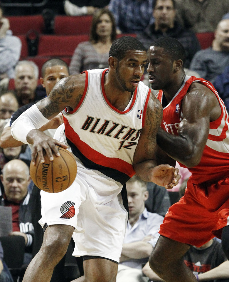 Portland Trail Blazers forward LaMarcus Aldridge, left, works the ball in against Houston Rockets forward Patrick Patterson during the first half of their NBA basketball game in Portland, Ore., Friday, Nov. 16, 2012. (AP Photo/Don Ryan)