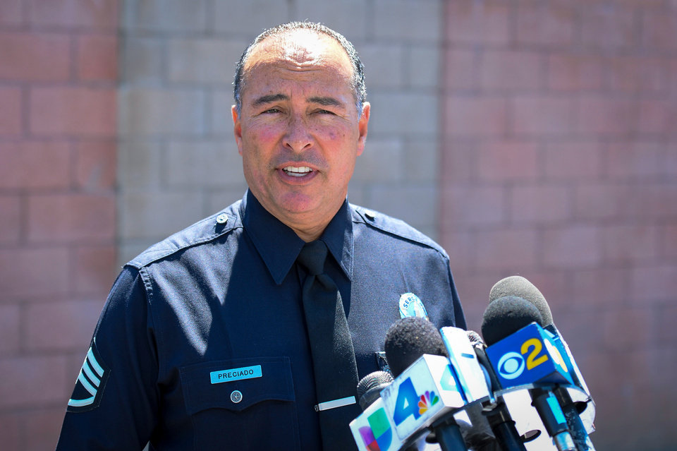 """Photo - Sgt. Frank Preciado of the LOs Angeles Police Department describes shootings which took place early Sunday morning, Aug. 24, 2014, in the San Fernando Valley which left 3 people dead. Describing what they called """"a major public threat,"""" Los Angeles police said they are seeking clues to three separate shootings in the Northeast San Fernando Valley that left three people dead and four others injured early Sunday morning and appear to be connected. A suspect in the shootings was taken into custody by SWAT officers Sunday night after holing up inside a house in the Sylmar neighborhood for about an hour, Capt. William Hayes said.   (AP Photo/Los Angeles Daily News,David Crane)"""
