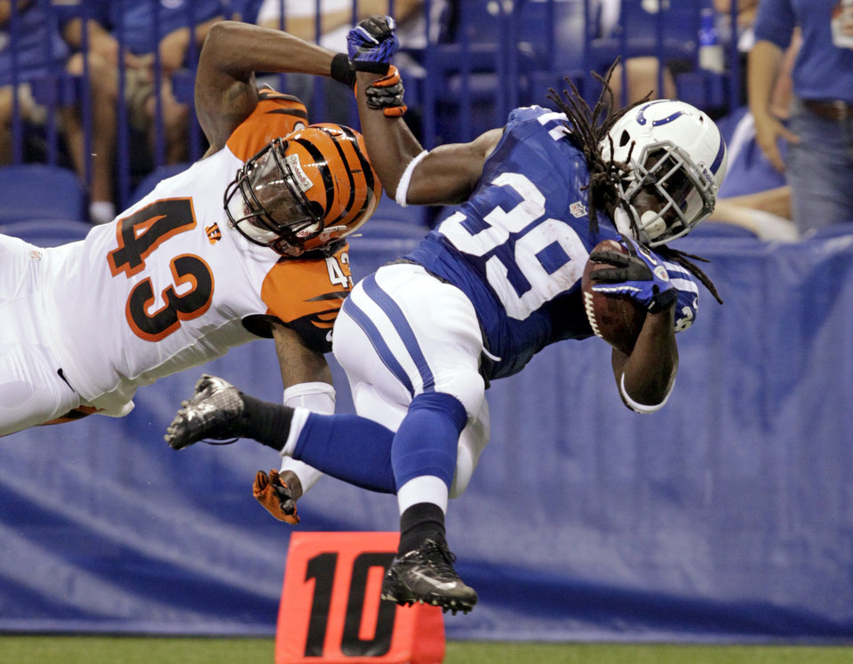 Photo -   Indianapolis Colts running back Deji Karim (39) is tackled from behind by Cincinnati Bengals free safety George Iloka in the first half of an NFL preseason football game in Indianapolis, Thursday, Aug. 30, 2012. (AP Photo/AJ Mast)
