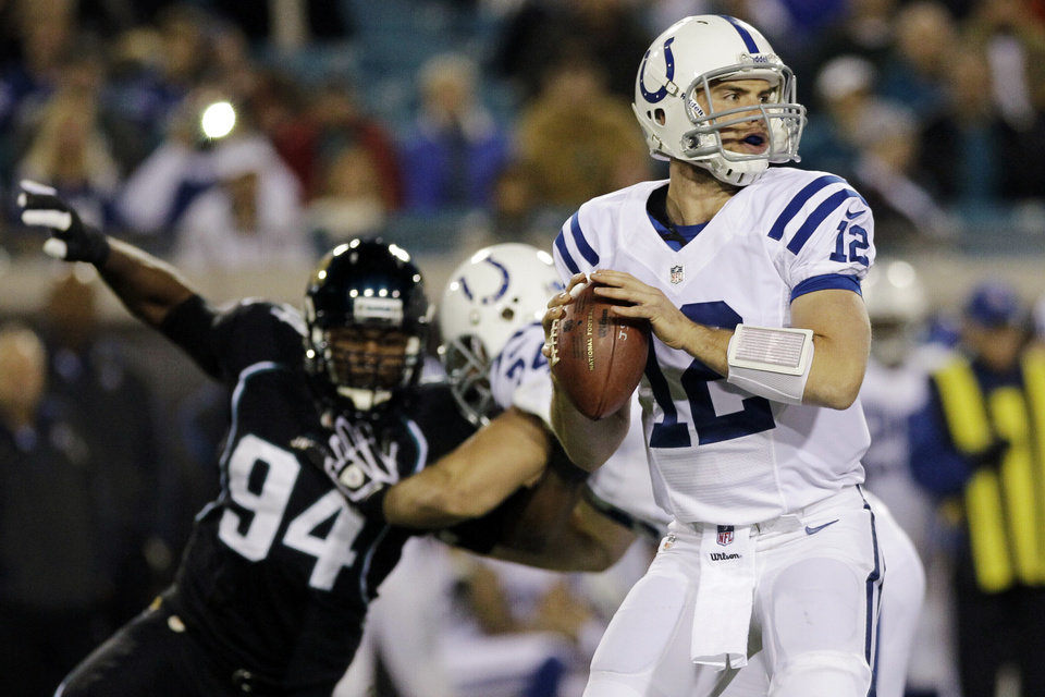 Photo -   Indianapolis Colts quarterback Andrew Luck (12) looks for a receiver as Jacksonville Jaguars defensive end Jeremy Mincey (94) tries to fight through a block during the first half of an NFL football game, Thursday, Nov. 8, 2012, in Jacksonville, Fla. (AP Photo/John Raoux)
