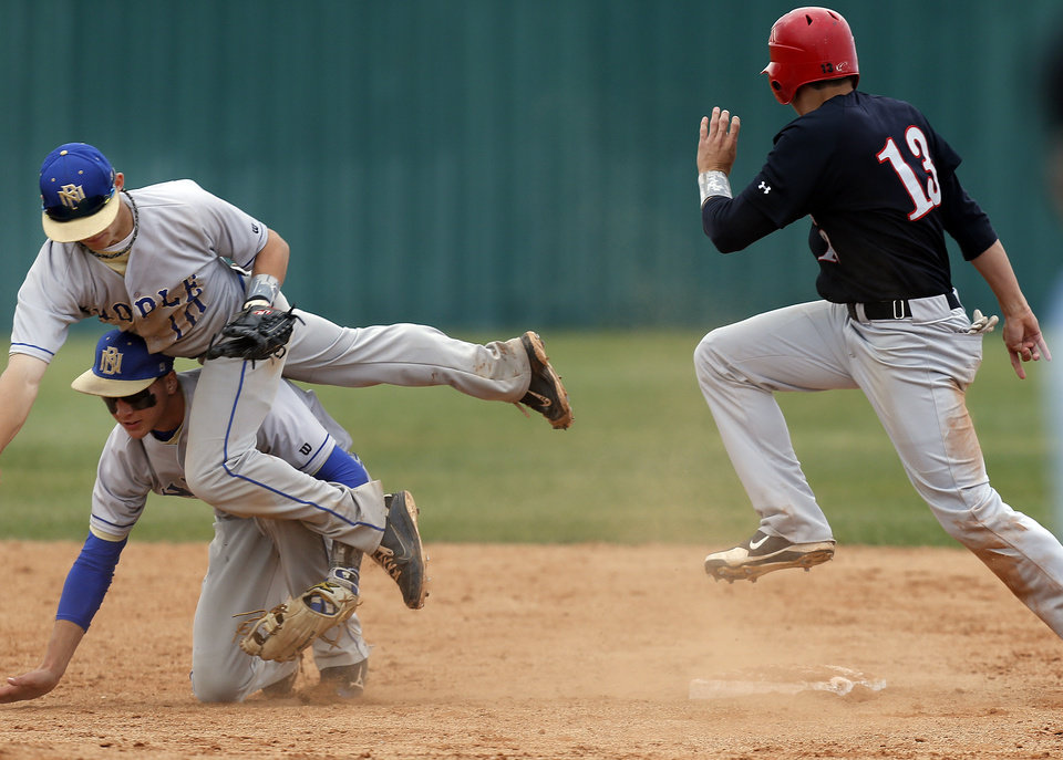 Noble's Trevor Lester, bottom, and Cory Jennings collide as Carl Albert's Steve Thompson rounds second during the 5A high school baseball state championship tournament at Edmond Memorial High School in Edmond, Okla.,  Friday, May 10, 2013. Photo by Sarah Phipps, The Oklahoman