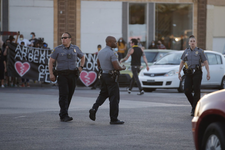 Photo - Oklahoma City police respond to protesters Saturday, May 30, 2020, near NW 23rd and Classen in Oklahoma City. Photo by Sarah Phipps