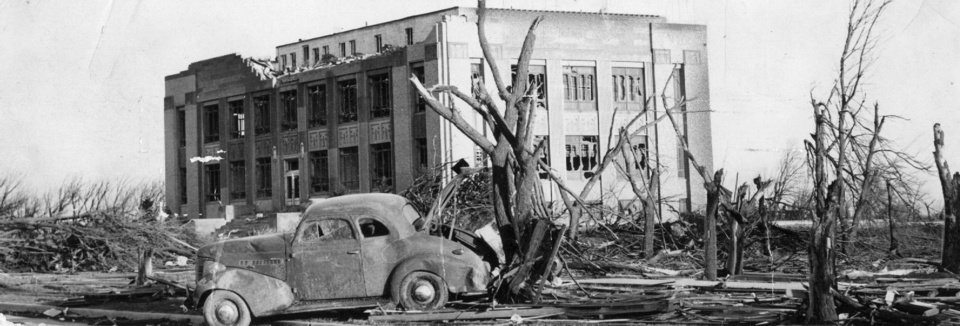 The April 9, 1947, tornado stripped tree limbs bare and left destruction in its path. The damaged Woodward County courthouse is shown in the background.   OKLAHOMAN ARCHIVE PHOTO <strong>FILE PHOTO 1947</strong>