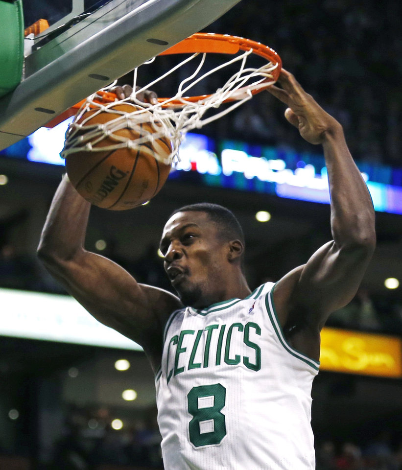 Boston Celtics forward Jeff Green (8) slams a dunk during the second quarter of an NBA basketball game against the Orlando Magic in Boston, Friday, Feb. 1, 2013. (AP Photo/Charles Krupa)