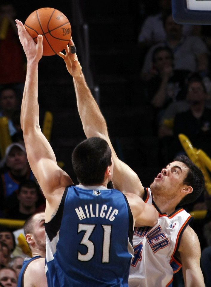 Photo - Oklahoma City's Nick Collison (4) blocks a shot by Minnesota's Darko Milicic (31) during the NBA basketball game between the Minnesota Timberwolves and the Oklahoma City Thunder at the Oklahoma City Arena, Monday, November 22, 2010, in Oklahoma City. The Thunder won, 117-107. Photo by Nate Billings, The Oklahoman