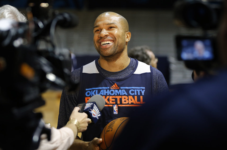 Photo - OKLAHOMA CITY THUNDER NBA BASKETBALL: Oklahoma City's Derek Fisher talks with the media before a Thunder practice at Rice University in Houston, Texas, Sunday., April 28, 2013. Photo by Bryan Terry, The Oklahoman