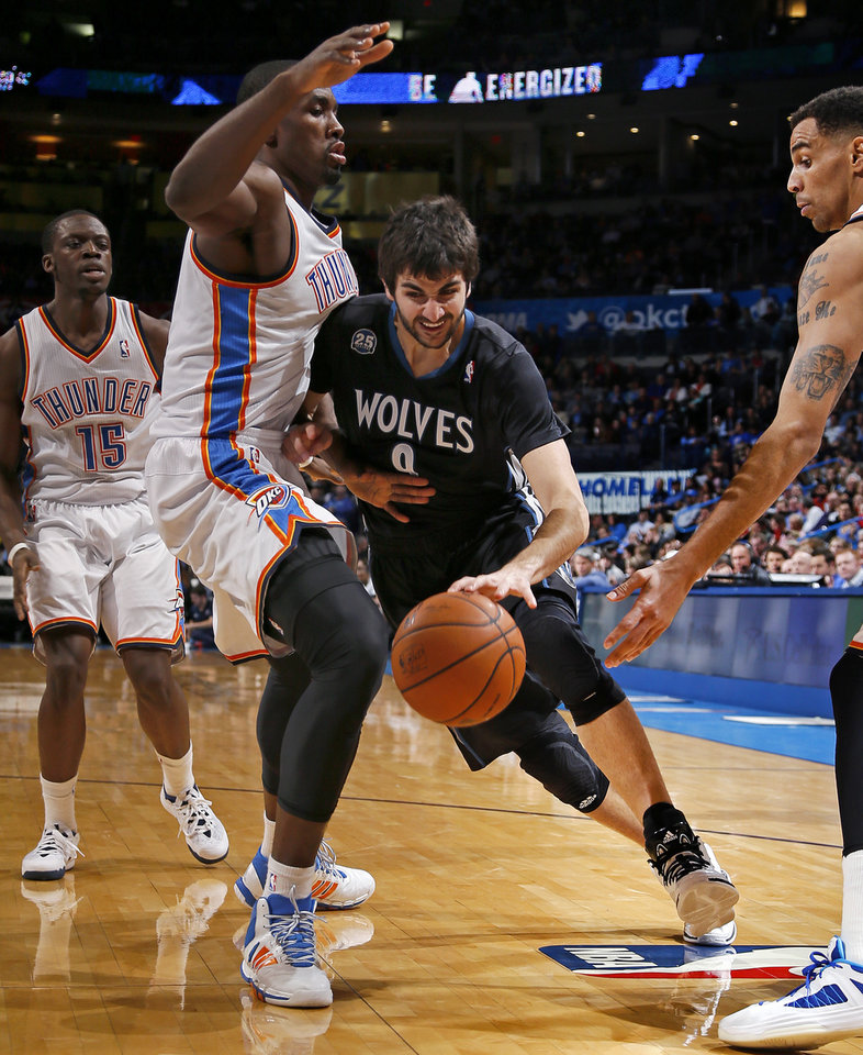 Minnesota\'s Ricky Rubio (9) tries to get past Oklahoma City\'s Serge Ibaka (9) as Reggie Jackson (15) and Thabo Sefolosha (25) watch during an NBA basketball game between the Oklahoma CIty Thunder and the Minnesota Timberwolves at Chesapeake Energy Arena in Oklahoma City, Wednesday, Feb. 5, 2014. Oklahoma City won 106-97. Photo by Bryan Terry, The Oklahoman