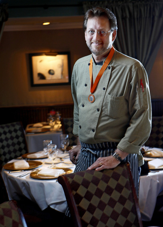 Photo - Chef Kurt Fleischfresser, winner of the Medaille de Merite, will have two seating at The Coach House on New Year's Eve.  BRYAN TERRY - THE OKLAHOMAN