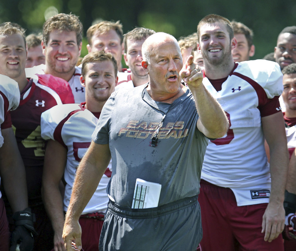 Photo - Boston College NCAA college football head coach Steve Addazio gestures after being doused during the