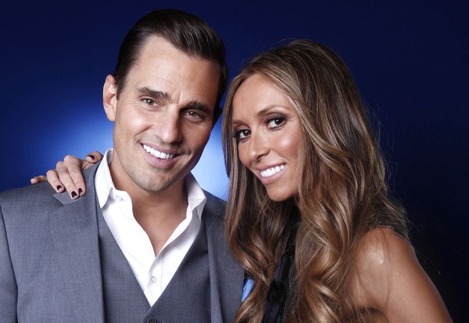 Bill and Giuliana Rancic pose for a portrait Apr. 2, 2012 in New York.    (AP Photo/Carlo Allegri)