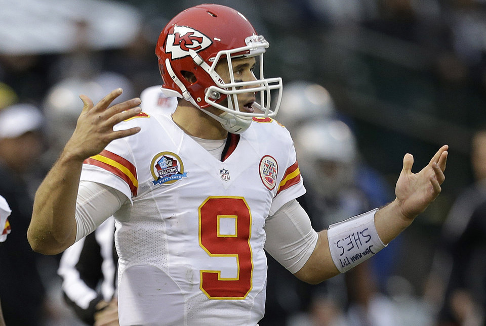 Photo - Kansas City Chiefs quarterback Brady Quinn (9) reacts as he looks toward the sideline during the third quarter of an NFL football game against the Oakland Raiders in Oakland, Calif., Sunday, Dec. 16, 2012. The Raiders won 15-0. (AP Photo/Ben Margot)