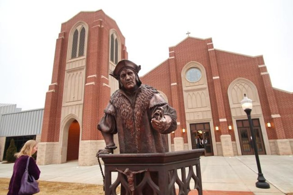 Photo -  A statue of St. Thomas More is featured in the plaza on the complex of the St. Thomas More University Parish and Student Center on the OU campus in Norman. [Doug Hoke/The Oklahoman]