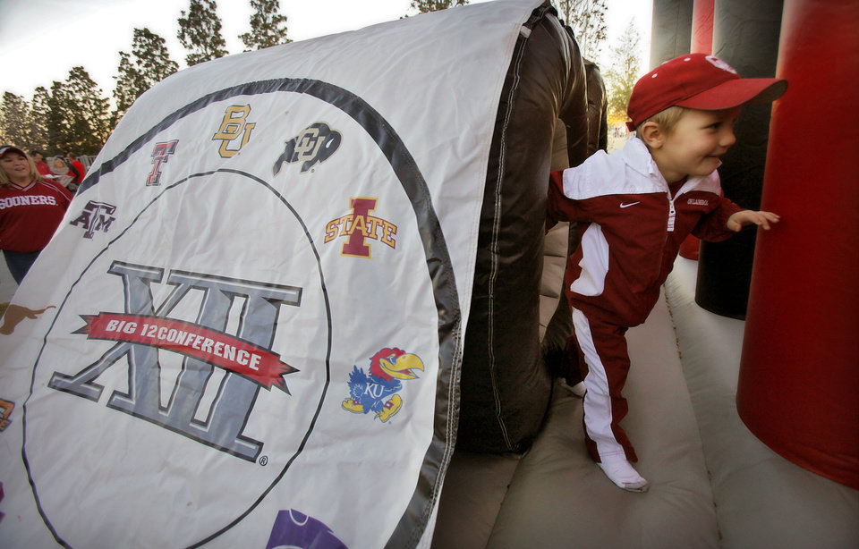 Photo - Jake Coles, 4, of Purcell goes through the Big 12 obstacle course during the Big 12 football championship game between the University of Oklahoma Sooners (OU) and the University of Nebraska Cornhuskers (NU) at Cowboys Stadium on Saturday, Dec. 4, 2010, in Arlington, Texas.  Photo by Chris Landsberger, The Oklahoman