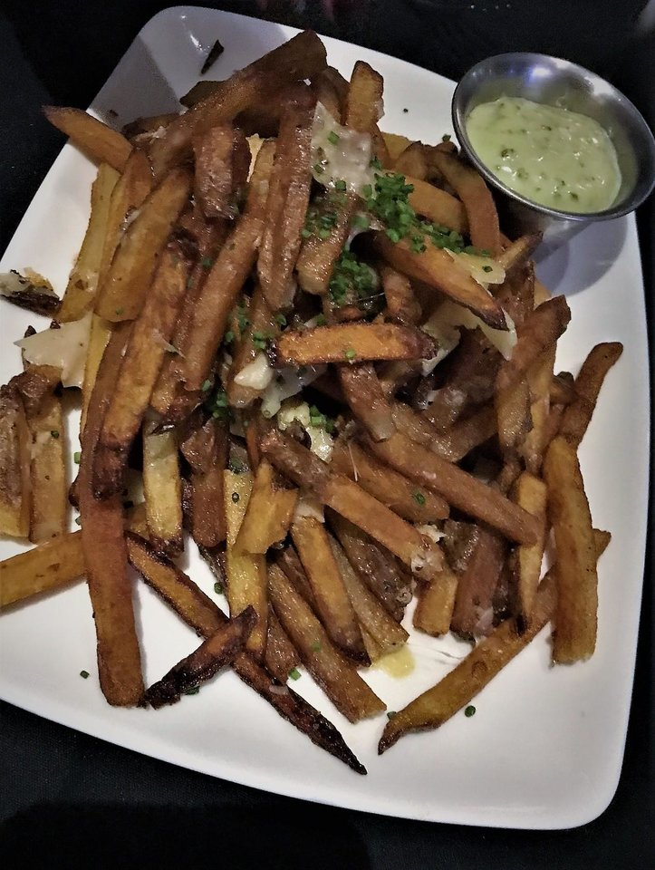 Photo -  Truffle fries from The Union Wood-Fired Grill in Oklahoma City. [Photo by Dave Cathey, The Oklahoman]