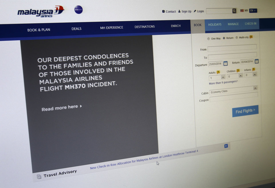 Photo - A sympathy message is displayed at the webpage of the Malaysia Airlines website, in Shah Alam, outside Kuala Lumpur, Malaysia, Tuesday, March 25, 2014. It was the grim news that families of the missing Malaysian Airlines flight had dreaded for weeks, and on Monday they heard it from Malaysia's prime minister: new analysis of satellite data indicates the missing plane crashed into a remote corner of the Indian Ocean. (AP Photo/Lai Seng Sin)