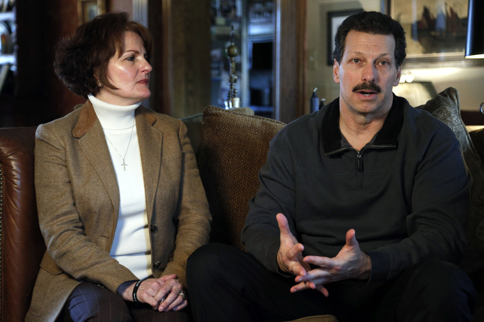 Photo - Vicki and Scott Behenna talk about the parole of their son, former U.S. Army 1st Lt. Michael Behenna, on Wednesday at their home in Edmond. Photo by Sarah Phipps, The Oklahoman  SARAH PHIPPS - THE OKLAHOMAN