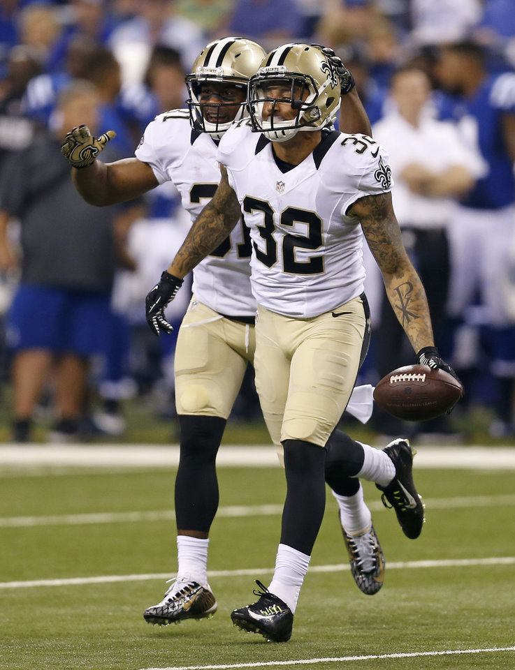 Photo - New Orleans Saints strong safety Kenny Vaccaro (32) and cornerback Patrick Robinson celebrate Vaccaro's interception against the Indianapolis Colts during the first half of an NFL preseason football game in Indianapolis, Saturday, Aug. 23, 2014. (AP Photo/Sam Riche)