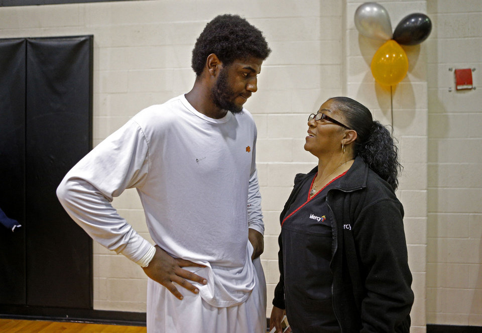 Photo - Dorshell Clark kisses talks with her son,  Deondre Clark, after his basketball game at Douglass High School in Oklahoma City, Tuesday, January 28, 2014. Photo by Bryan Terry, The Oklahoman
