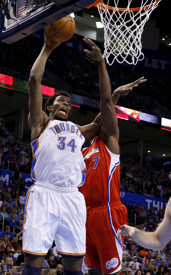 Photo - Oklahoma City's Hasheem Thabeet (34) is fouled by the Clippers Lamar Odom (7) during an NBA basketball game between the Oklahoma City Thunder and the Los Angeles Clippers at Chesapeake Energy Arena in Oklahoma City, Wednesday, Nov. 21, 2012. Photo by Bryan Terry, The Oklahoman