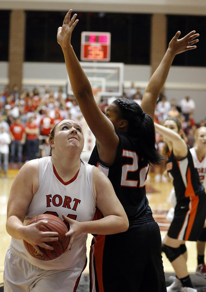 Fort Gibson's Brooke Palmer looks to shoot a basket as Cushing's Che'ron Lewis defends during the 4A girls high school basketball game in the semifinals of the state tournament between Cushing and Fort Gibson at Southern Nazarene University in Oklahoma City, Friday, March 8, 2013. Photo by Sarah Phipps, The Oklahoman