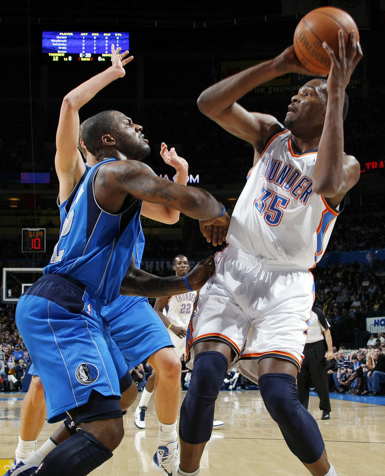 Oklahoma City's Kevin Durant (35) tries to shoot over DeShawn Stevenson (92) of Dallas during the NBA basketball game between the Dallas Mavericks and the Oklahoma City Thunder at the Oklahoma City Arena in Oklahoma City, Monday, Dec. 27, 2010. Photo by Nate Billings, The Oklahoman