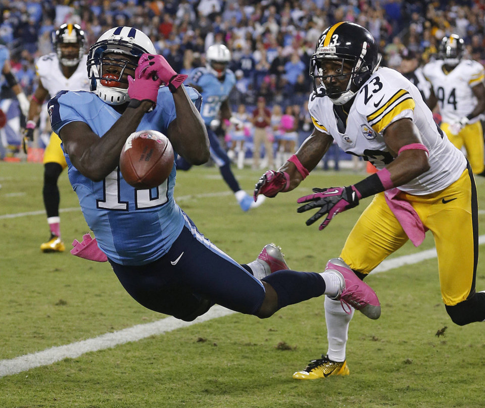 Tennessee Titans wide receiver Kendall Wright (13) can\'t make a catch as Pittsburgh Steelers cornerback Keenan Lewis (23) defends during the first half of an NFL football game Thursday, Oct. 11, 2012, in Nashville, Tenn. (AP Photo/Joe Howell)