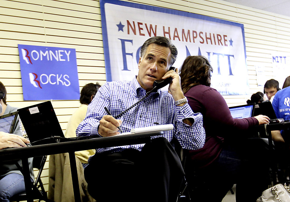 FILE - In this Oct. 22, 2011 file photo, Republican presidential candidate, former Massachusetts Gov. Mitt Romney works with volunteers making calls while visiting his Romney For President New Hampshire Headquarters in Manchester, N.H. Whether they like it or not, Republican presidential candidates are joining New Hampshire's intensifying gay marriage debate. State lawmakers plan in the coming weeks to take up measure to repeal the law allowing same-sex couples to wed and a vote expected at some point in January _ the same month as New Hampshire holds the nation's first Republican presidential primary contest. (AP Photo/Cheryl Senter, File)
