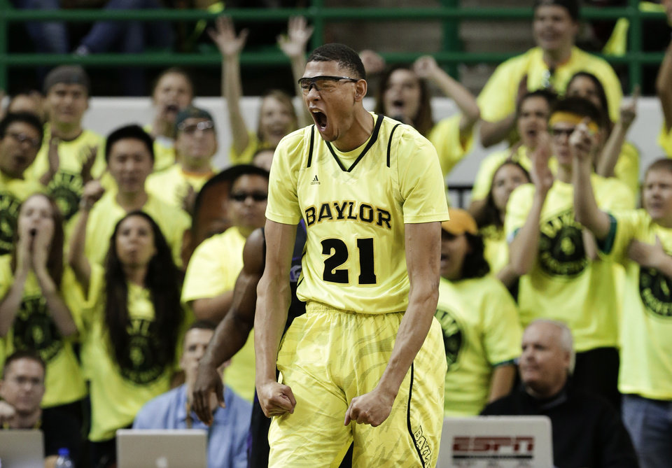 Baylor\'s Isaiah Austin (21) celebrates after scoring against Kansas State in the first half of an NCAA college basketball game onSaturday, March 2, 2013, in Waco, Texas. (AP Photo/Tony Gutierrez)