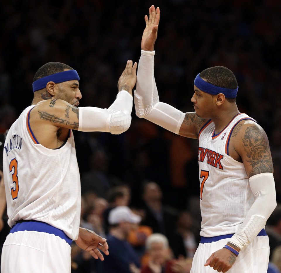 Photo - New York Knicks forward Kenyon Martin, left, and teammate Carmelo Anthony celebrate after the Knicks went ahead in the fourth quarter of Game 1 of the NBA basketball playoffs in New York, Saturday, April 20, 2013.  (AP Photo/Kathy Willens)in New York, Saturday, April 20, 2013.  The Knicks defeated Celtics 85-78. (AP Photo/Kathy Willens)