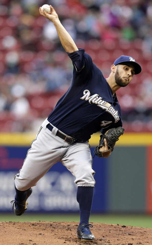 Photo - Milwaukee Brewers starting pitcher Marco Estrada throws against the Cincinnati Reds in the first inning of a baseball game, Thursday, May 1, 2014, in Cincinnati. (AP Photo/Al Behrman)