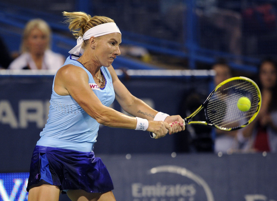 Photo - Svetlana Kuznetsova, of Russia, chases the ball against Ekaterina Makarova, of Russia, during a match at the Citi Open tennis tournament, Saturday, Aug. 2, 2014, in Washington. (AP Photo/Nick Wass)