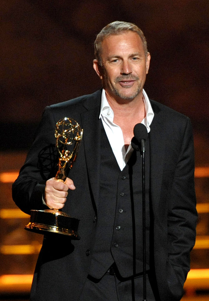"Kevin Costner accepts the award for outstanding lead actor in a miniseries or movie for ""Hatfields & McCoys"" at the 64th Primetime Emmy Awards at the Nokia Theatre on Sunday, Sept. 23, 2012, in Los Angeles. (Photo by John Shearer/Invision/AP)"