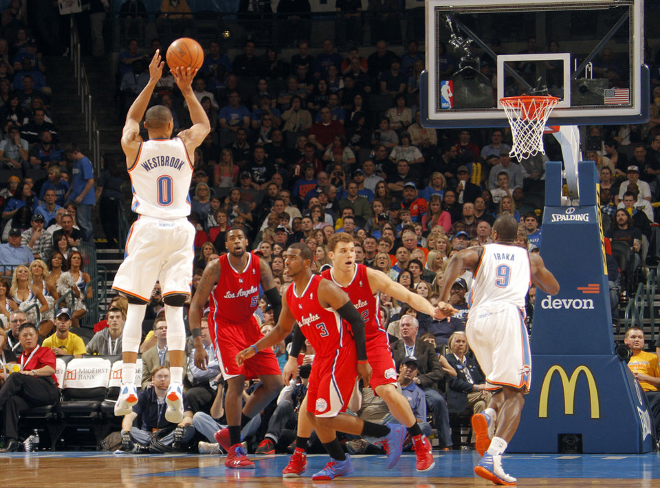 Photo - Oklahoma City Thunder point guard Russell Westbrook (0) puts up a shot during the NBA basketball game between the Oklahoma City Thunder and the Los Angeles Clippers at Chesapeake Energy Arena on Wednesday, March 21, 2012 in Oklahoma City, Okla.  Photo by Chris Landsberger, The Oklahoman
