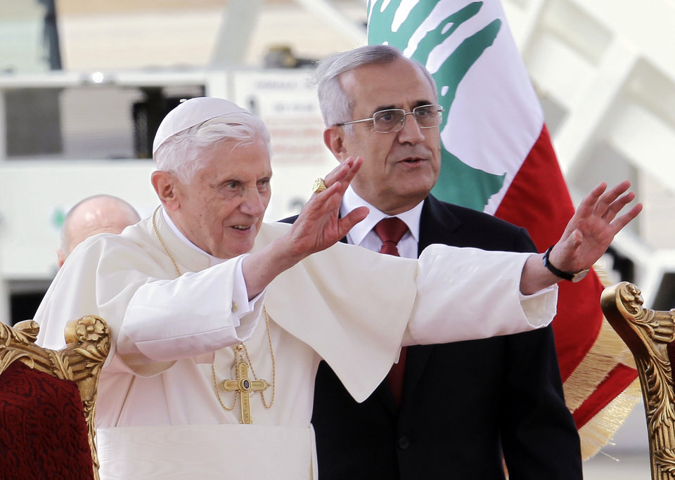 Photo -   Pope Benedict XVI stands next to Lebanese President Michel Suleiman as he waves to the crowd at Rafik Hariri international airport, in Beirut, Lebanon, Friday, Sept. 14, 2012. Pope Benedict XVI arrived in Lebanon on Friday to urge peace at a time of great turmoil in the Middle East, saying the import of weapons to Syria during the country's civil war is a