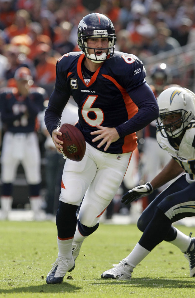 Photo - Denver Broncos quarterback Jay Cutler (6) scrambles against San Diego Chargers linebacker Jyles Tucker (94) during the second quarter of an NFL football game in Denver, Sunday, Sept. 14, 2008. (AP Photo/Jack Dempsey) ORG XMIT: COJD106