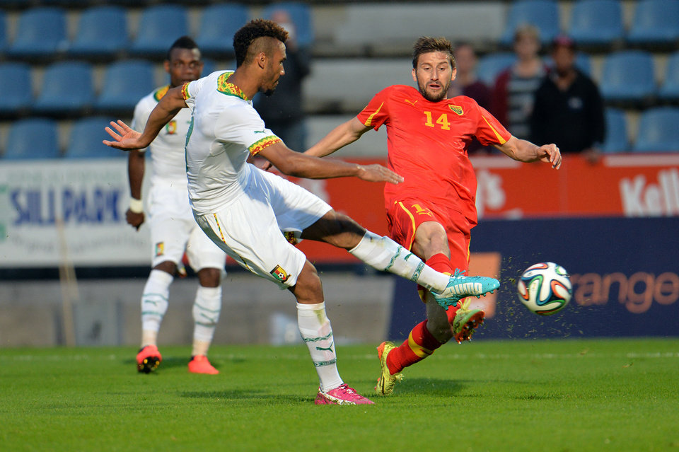 Photo - Cameroon's Mouting Choupo scores during their friendly soccer match against Macedonia in Kufstein, in the Austrian province of Tyrol, on Monday, May 26, 2014. (AP Photo/Kerstin Joensson)
